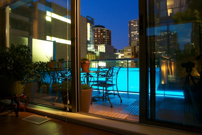 Decorative lights will add ambiance to your condo balcony design.