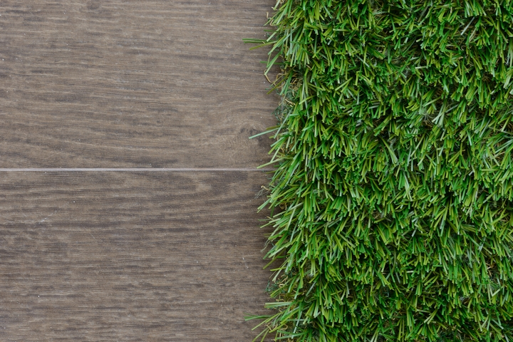 Synthetic grass tiles are great condo balcony design ideas.
