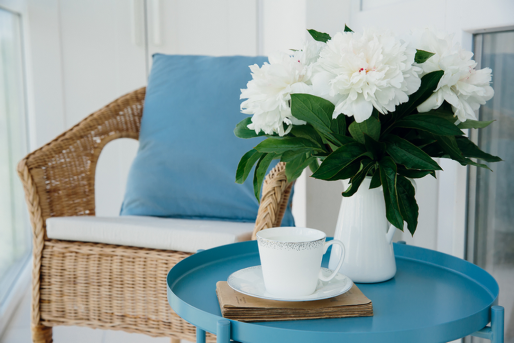 Try to mix and match different furniture styles for your condo balcony lounge.