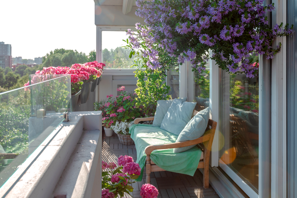 A good balcony lounge idea is to decorate it with flowers and plants.