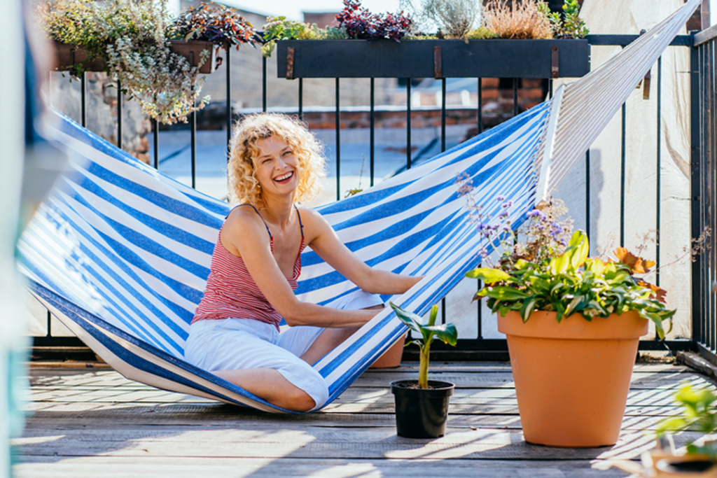 Setting up a hammock can be a great balcony lounge idea for small condos.